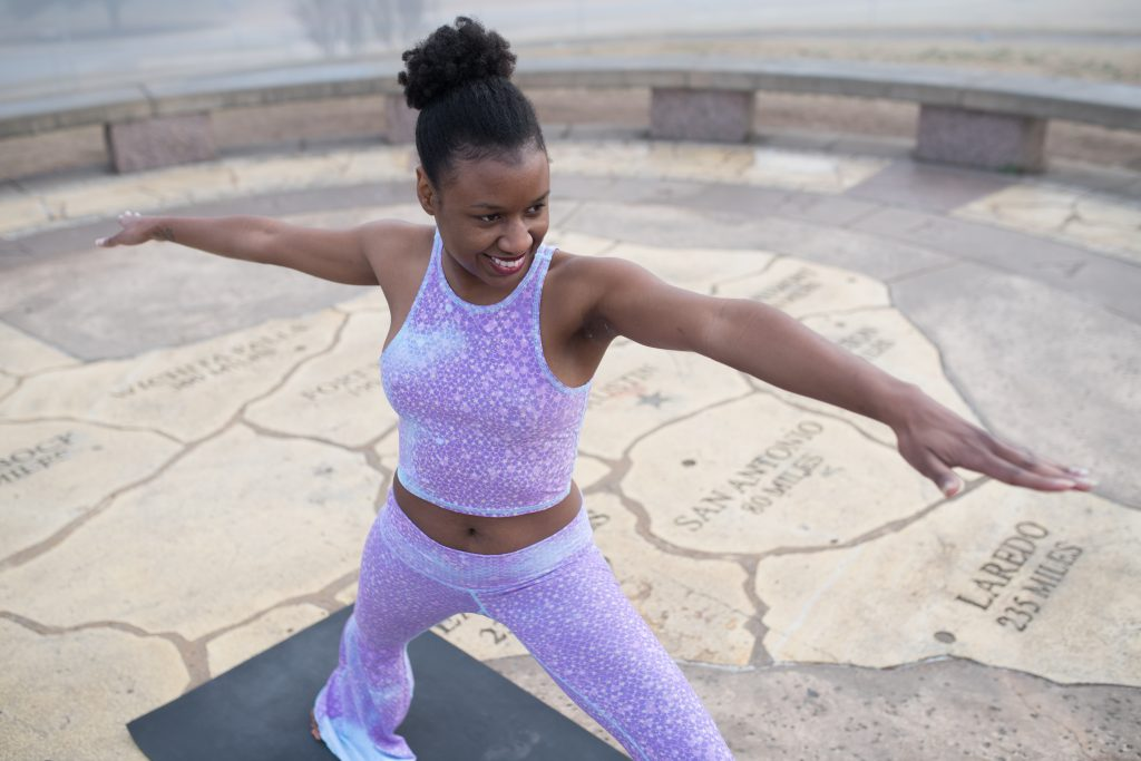 black woman doing yoga