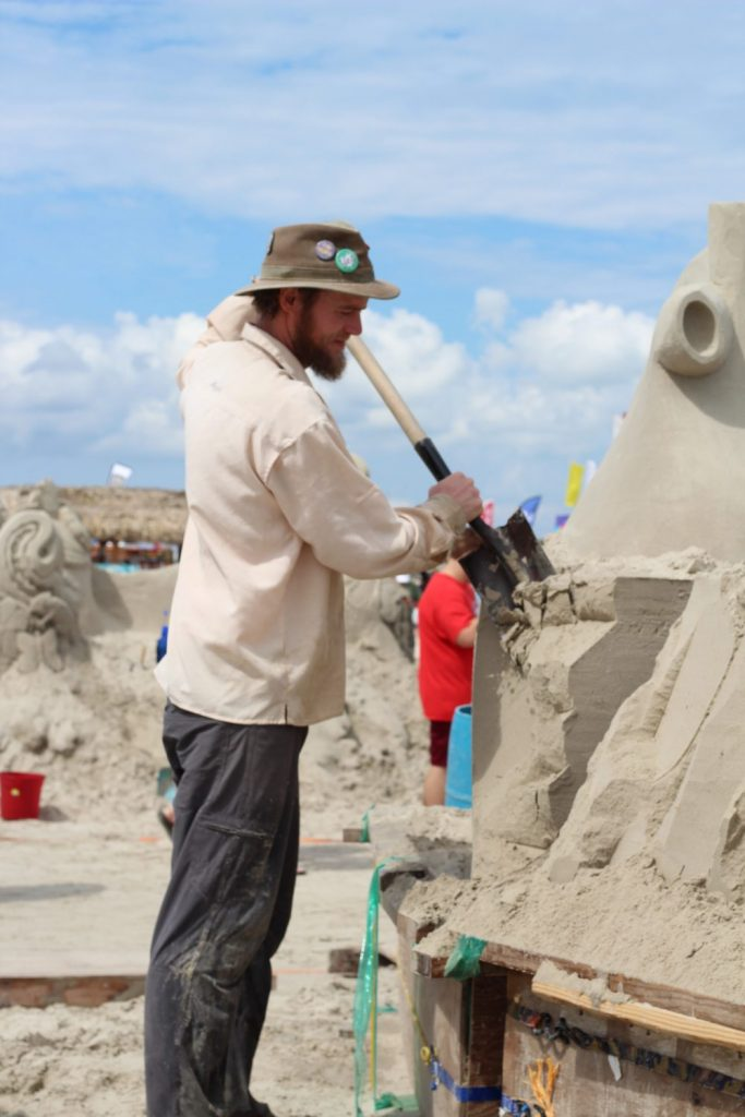 man building sand castle