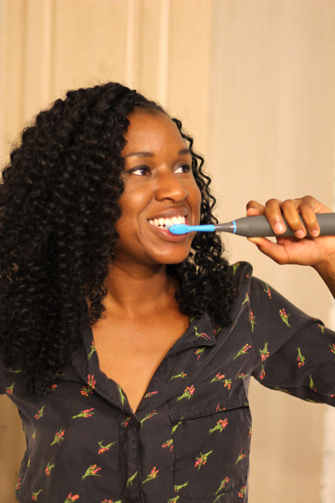 black woman brushing teeth