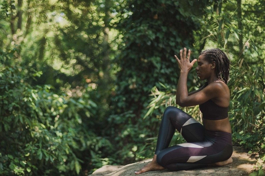 black woman performing yoga