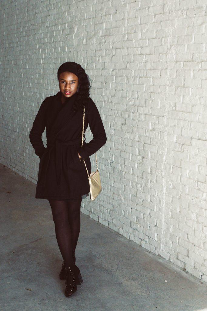 woman wearing black wrap coat