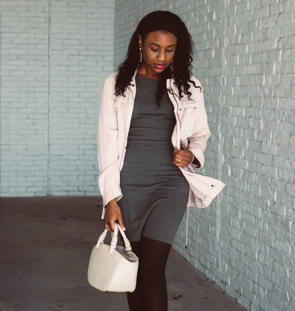 black woman wearing a pink utility jacket