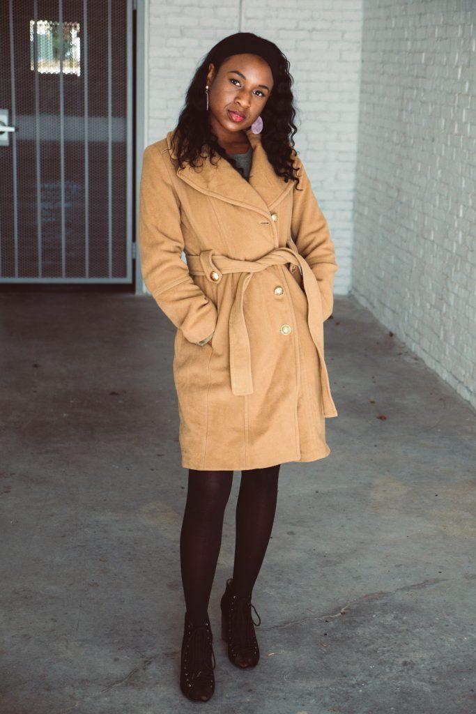 black woman wearing camel trench coat