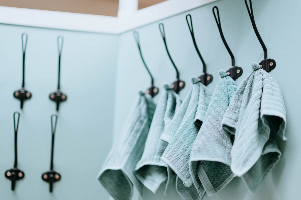 bath towels hanging on hooks in bathroom