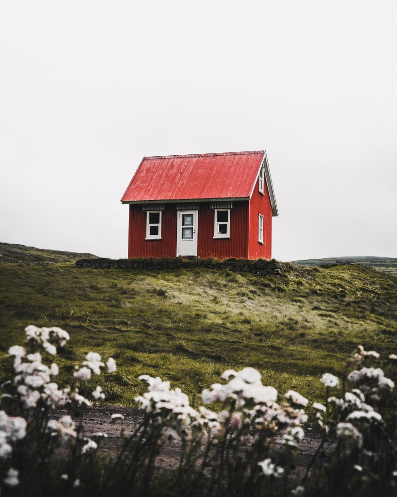 tiny red home on top of the hill