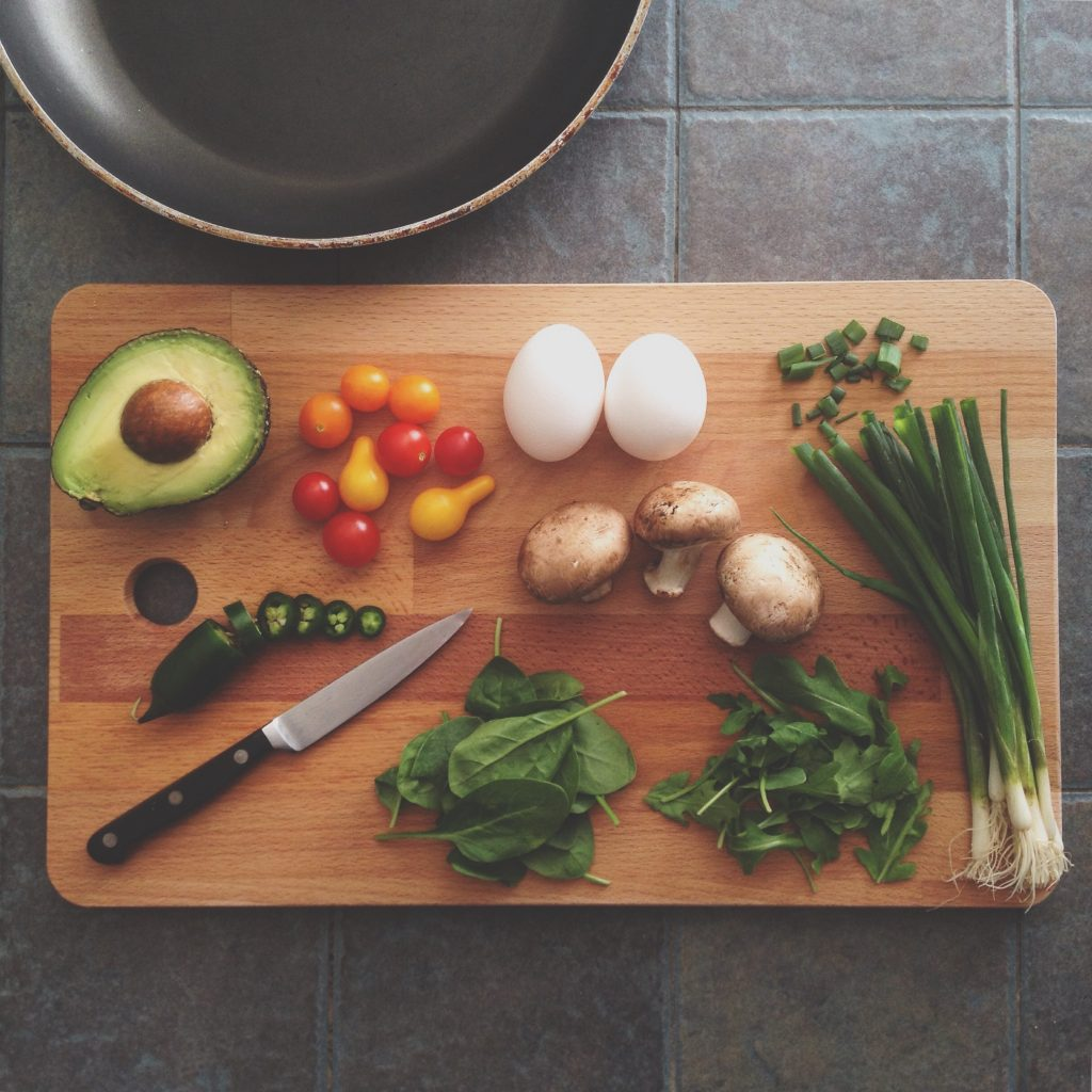 Vegetable and herbs on a cutting board