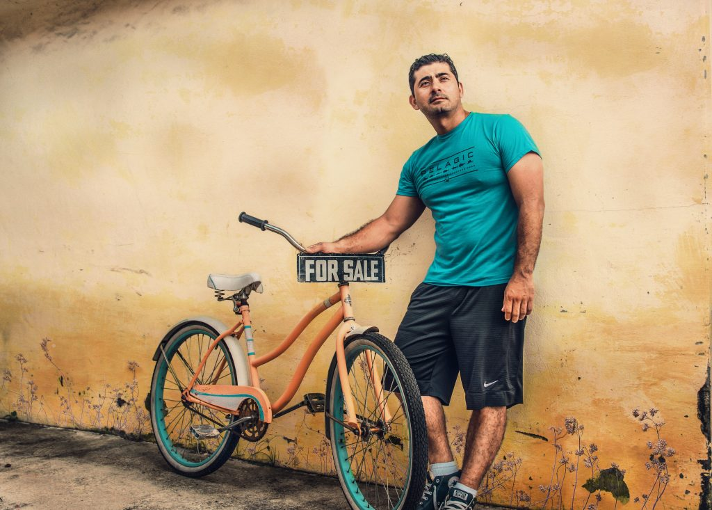 man with bike for sale