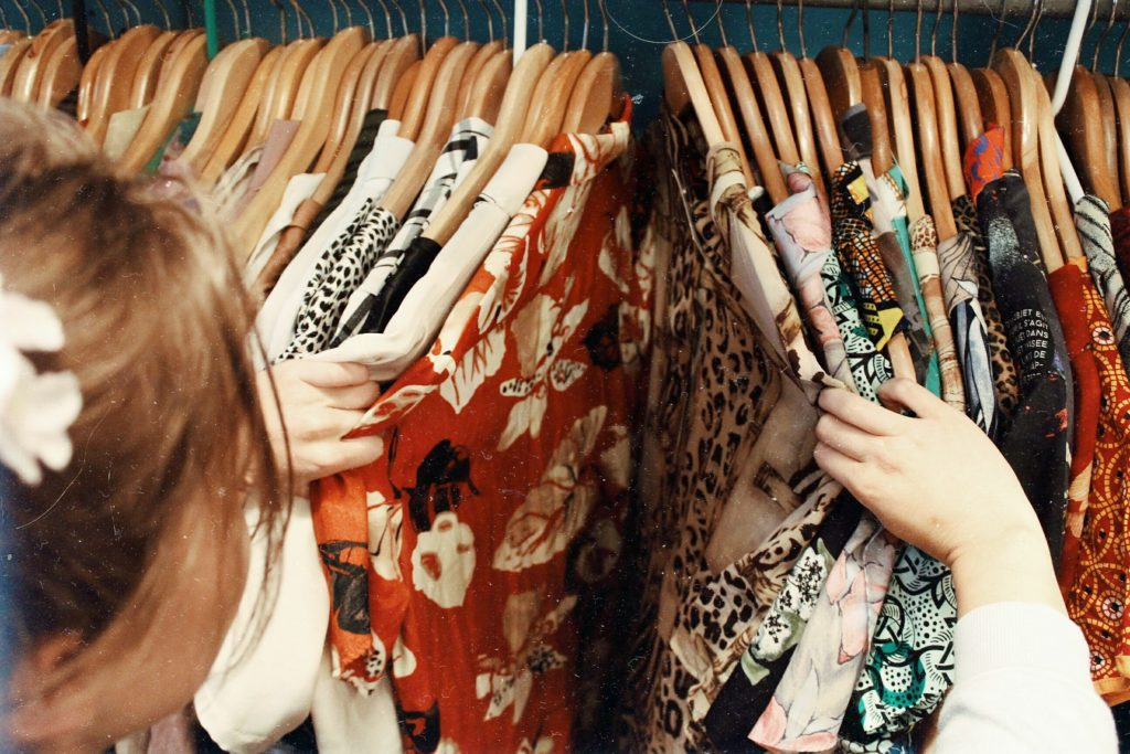 woman perusing clothes on a rack