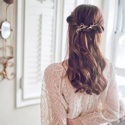 woman wearing branch hair pin